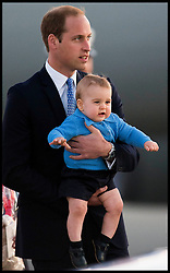 Their Royal Highnesses The Duke of Cambridge and The Duchess of Cambridge with baby son Prince George arrive in Canberra, Australia,<br /> The Royal Family touched down on a RAAF plane at Fairbairn Airport in preparation for the next leg of the Royal Visit to Australia on day 14 of their Royal Tour, Sunday, 20th April 2014. Picture by  i-Images / i-Images