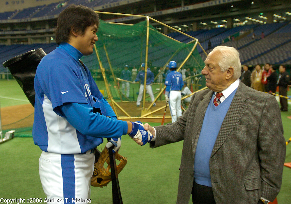 Korea's Hee Seop Choi shakes hands with Tommy Lasorda during warmups before the start of the Korea/Chinese Taipei World Baseball Classic opening game at Tokyo Dome, Tokyo, Japan