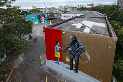 November 12, 2016 - Sao Paulo, Brazil - A group of artists participating in the event sponsored by the Military Police of Sao Paulo, to paint with spray the walls of elite troop barracks. The event called Choque Festival, held on Saturday 12 and Sunday 13, is open to all and visitors can also paint with the artists. (Credit Image: © Paulo Lopes via ZUMA Wire)