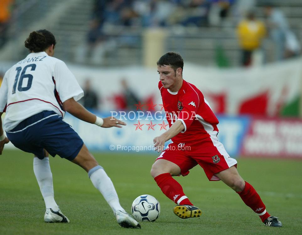 SAN JOSE, USA - Tuesday, May 27, 2003: Wales' Jason Koumas and USA's Ryan Suarez during the Friendly International match at the Spartan Stadium. (Pic by David Rawcliffe/Propaganda)