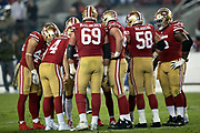 The San Francisco 49ers offense huddles and calls a play during the NFL week 10 regular season football game against the New York Giants on Monday, Nov. 12, 2018 in Santa Clara, Calif. The Giants won the game 27-23. (©Paul Anthony Spinelli)