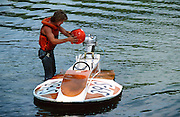 Friend Gary Williams getting ready to go for a test run on the Miami River near Dayton, Oh. Gary has since become a total boat geek and lives in Florida where he gets to go for a ride in a  boat almost 365 days a year -- nice work if you can get it -- and he did!
