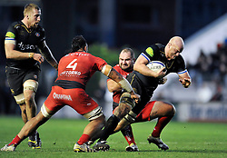 Matt Garvey of Bath Rugby takes on the Toulon defence - Mandatory byline: Patrick Khachfe/JMP - 07966 386802 - 10/01/2016 - RUGBY UNION - Stade Mayol - Toulon, France - RC Toulon v Bath Rugby - European Rugby Champions Cup.