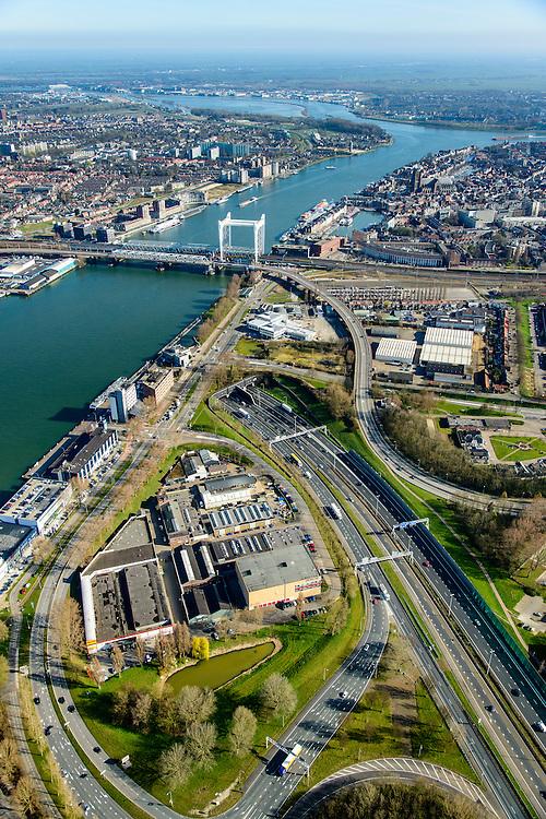 Nederland, Zuid-Holland, Dordrecht, 01-04-2016; overzicht binnenstad van Dordrecht met karakteristieke spoorbrug over rivier de Oude Maas.<br /> Ingang Drechttunnel.<br /> Overview city of Dordrecht located on the Oude Maas river.<br /> <br /> luchtfoto (toeslag op standard tarieven);<br /> aerial photo (additional fee required);<br /> copyright foto/photo Siebe Swart