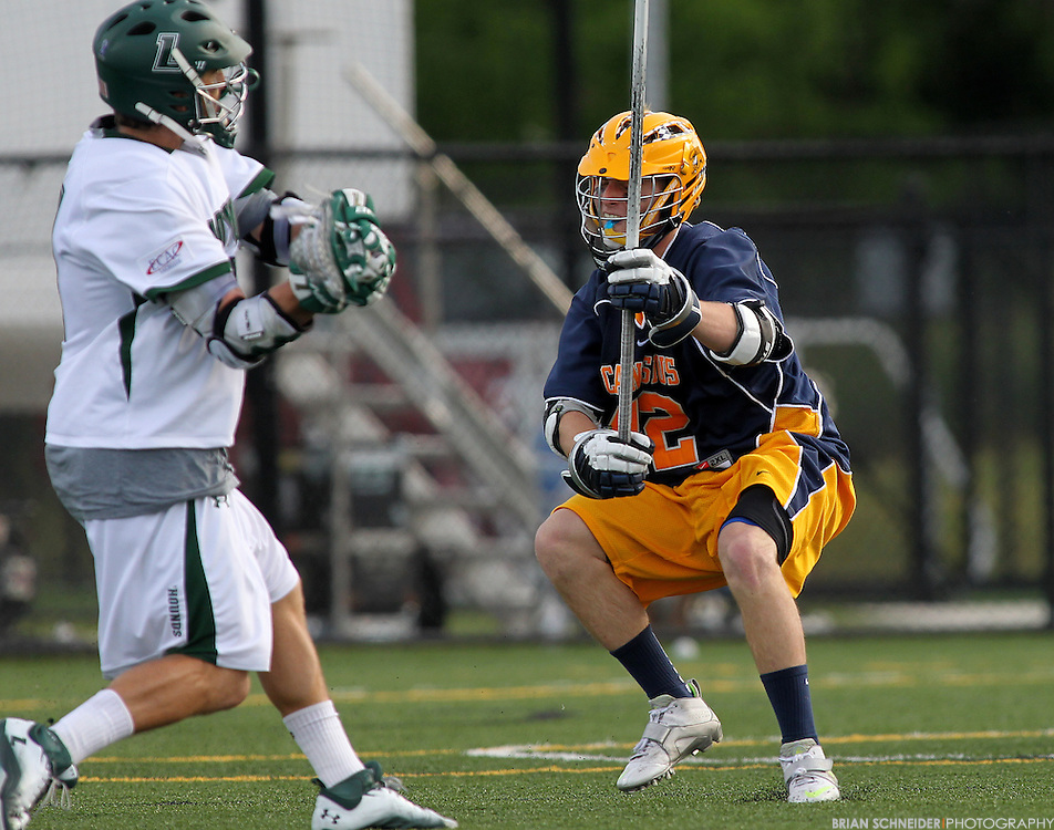 May 12, 2012; Baltimore, MD, USA; Canisius College Golden Griffins defender Brendan Murphy (42) against Loyola Maryland Greyhounds at Ridley Athletic Complex in Baltimore, MD. Mandatory Credit: Brian Schneider-www.ebrianschneider.com