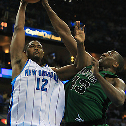 11 February 2009:  New Orleans Hornets center Hilton Armstrong (12) shoots as Boston Celtics center Kendrick Perkins (43) defends the play during a 89-77 loss by the New Orleans Hornets to the Boston Celtics at the New Orleans Arena in New Orleans, LA.