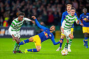 Dedryck Boyata (#20) of Celtic FC fouls Matheus Cunha (#20) of RB Leipzig during the Europa League group stage match between Celtic and RP Leipzig at Celtic Park, Glasgow, Scotland on 8 November 2018.