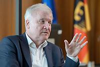 01 JUL 2019, BERLIN/GERMANY:<br /> Horst Seehofer, CSU, Bundesinnenminister, waehrend einem Interview, in seinem Buero, Bundesministerium des Inneren<br /> IMAGE: 20190701-01-053<br /> KEYWORDS: Büro