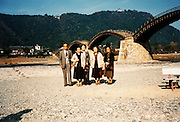posing on the banks of the Nishiki river with the traditional old style Kintai bridge Japan 1980