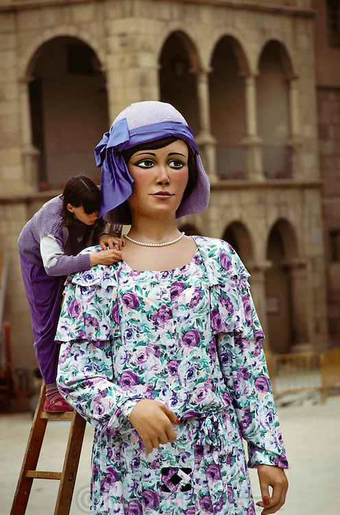 Dressing a gigante (giant puppet to be used in a procession.) Pueblo Espanol, Barcelona, Spain.