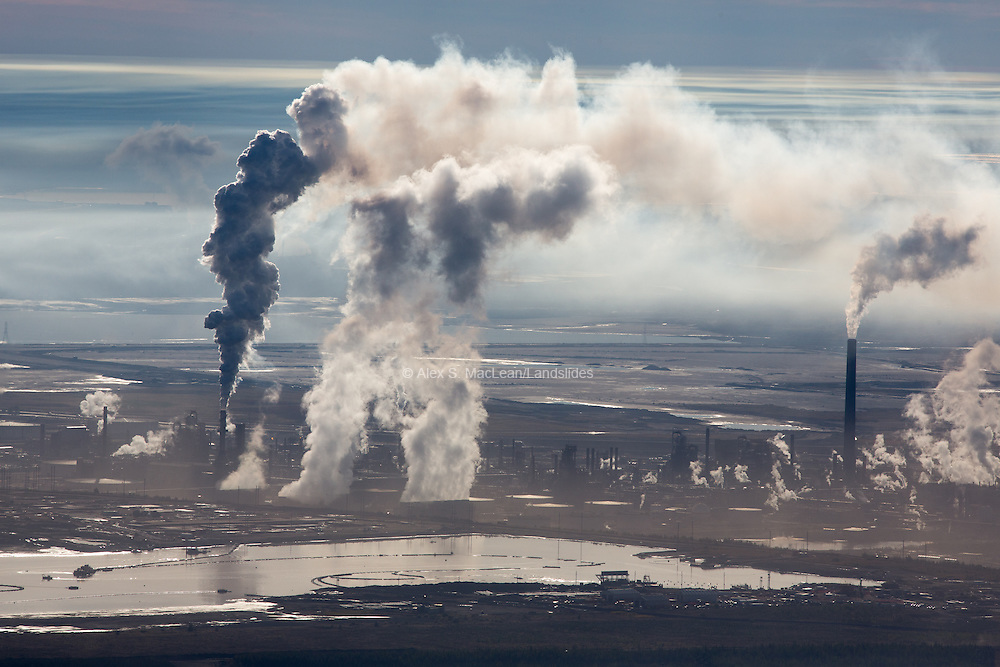 Steam and smoke rise from upgrading facility at Syncrude Mildred Lake Mine