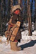 Tsaatan boy with pack saddle<br /> Nomadic tribe with +-200 individuals left who still live in teepees<br /> Taiga Forest<br /> Northern Mongolia