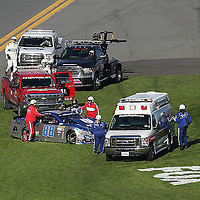 Dale Earnhardt Jr. (88) climbs from his car after he spun out on the fronstretch during the 58th Annual NASCAR Daytona 500 auto race at Daytona International Speedway on Sunday, February 21, 2016 in Daytona Beach, Florida.  (Alex Menendez via AP)