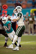 New York Jets rookie quarterback Sam Darnold (14) throws a second quarter pass during the NFL week 9 regular season football game against the Miami Dolphins on Sunday, Nov. 4, 2018 in Miami Gardens, Fla. The Dolphins won the game 13-6. (©Paul Anthony Spinelli)