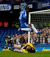 Photo: Ed Godden/Sportsbeat Images.<br />Chelsea v Wigan Athletic. The Barclays Premiership. 13/01/2007. Chelsea's Salomon Kalou leaps over Chris Kirkland as the Wigan keeper makes a brave save.