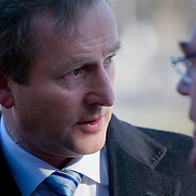 February 9, 2012 - New York, NY :.Taoiseach (Irish Prime Minister) Enda Kenny  speaks with Tanaiste (deputy Irish Prime Minister) Eamon Gilmore, at right, in Washington Square Park in New York city prior to a roundtable with Irish-American business leaders and former U.S. President Bill Clinton on Thursday morning, Feb. 9, 2012..CREDIT: Karsten Moran for The Irish Independent