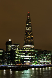 © Licensed to London News Pictures. 19/03/2016. London, UK. The Shard in London seen with the spire lights turned off for Earth Hour 2016. Landmarks around the world are switching their lights off for Earth Hour this evening, a global switch-off event aimed at protecting the planet and highlighting the effects of climate change. This year marks the 10th annual Earth Hour. Photo credit : Vickie Flores/LNP