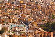 A steep neighborhood of boxy concrete buildings in Amman, Jordan