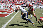 San Diego Chargers running back Ryan Mathews (24) is chased by leaping San Francisco 49ers inside linebacker Patrick Willis (52) as he scores a first quarter touchdown after a 25 yard pass reception and run, though the score was called back due to a penalty, during the 2014 NFL preseason football game against the San Franisco 49ers on Sunday, Aug. 24, 2014 in Santa Clara, Calif. The 49ers won the game 21-7. ©Paul Anthony Spinelli