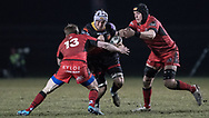 Dragons' Ollie Griffiths tries to find a way through Edinburghs' James Johnstone (left) and Lewis Carmichael (right).<br /> <br /> Photographer Simon Latham/Replay Images<br /> <br /> Guinness PRO14 - Dragons v Edinburgh - Friday 23rd February 2018 - Eugene Cross Park - Ebbw Vale<br /> <br /> World Copyright &copy; Replay Images . All rights reserved. info@replayimages.co.uk - http://replayimages.co.uk