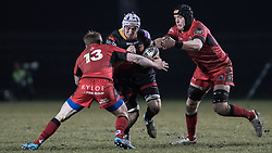 Dragons' Ollie Griffiths tries to find a way through Edinburghs' James Johnstone (left) and Lewis Carmichael (right).<br /> <br /> Photographer Simon Latham/Replay Images<br /> <br /> Guinness PRO14 - Dragons v Edinburgh - Friday 23rd February 2018 - Eugene Cross Park - Ebbw Vale<br /> <br /> World Copyright © Replay Images . All rights reserved. info@replayimages.co.uk - http://replayimages.co.uk