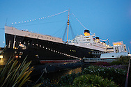 The Queen Mary Hotel at dusk in Long Beach, California.