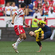 Tim Cahill, (left), New York Red Bulls, fouls Jack Wilshere, Arsenal, which resulted in a yellow card during the New York Red Bulls Vs Arsenal FC, friendly football match for the New York Cup at Red Bull Arena, Harrison, New Jersey. USA. 26h July 2014. Photo Tim Clayton