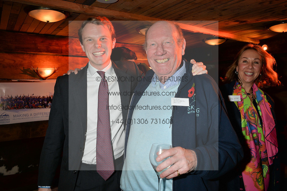 Left to right, JACK BROOKSBANK and his father GEORGE BROOKSBANK at Skiing With Heroes Junior Committee Awareness Party held at Bodo's Schloss, 2A Kensington High Street, London on 6th November 2014.