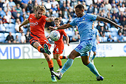 Wycombe Wanderers defender Jason McCarthy (26) clears in front of Coventry City striker Jonson Clarke-Harris (18) during the EFL Sky Bet League 1 match between Coventry City and Wycombe Wanderers at the Ricoh Arena, Coventry, England on 13 October 2018.