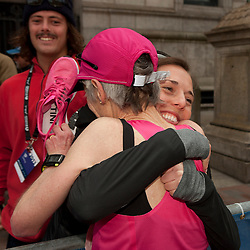 2013 Boston Marathon: Joan Samuelson finishes and greets here kids Anders, Abby
