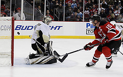 Dec 30, 2009; Newark, NJ, USA; Pittsburgh Penguins goalie Brent Johnson (1) makes a save on New Jersey Devils right wing Jamie Langenbrunner (15) during the second period at the Prudential Center.