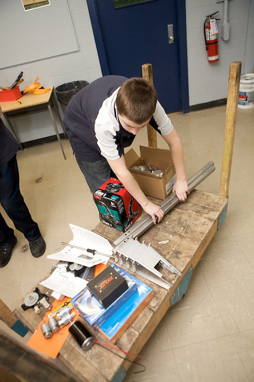 Fusion Jeunesse - Youth Fusion students from Ecole H-Mercier open and begin to sort through parts and tools they received from the FIRST Robotics competition. The parts will be used to construct a robot that the students will enter in the FIRST Robotics competition in the coming weeks.