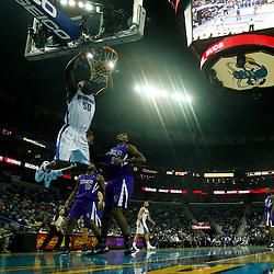December 15, 2010; New Orleans Hornets center Emeka Okafor (50) dunks during the first half against the Sacramento Kings at the New Orleans Arena. The Hornets defeated the Kings 94-91. Mandatory Credit: Derick E. Hingle