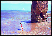 Young Fisherman by Star Nigro<br /> <br /> This moment was captured on an island off of the coast of Bahia,Brazil. This child fishing added a lively addition to this otherwise mysterious ruin on the beach.<br /> <br /> <br /> © 2019 All artwork is the property of STAR NIGRO.  Reproduction is strictly prohibited.