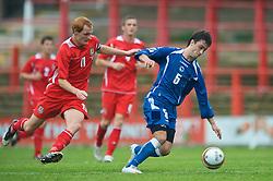 WREXHAM, WALES - Saturday, October 10, 2009: Wales' Shaun MacDonald and Bosnia-Herzegovina's Goran Galesic during the UEFA Under-21 Championship Qualifying Round Group 3 match at the Racecourse Ground. (Pic by Chris Brunskill/Propaganda)