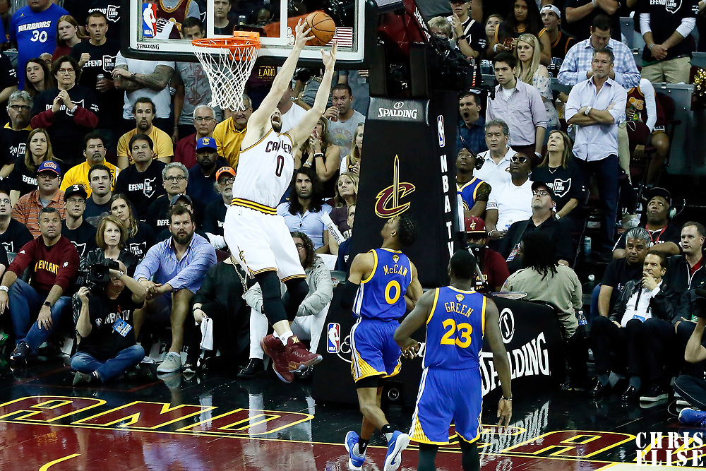 09 June 2017: Cleveland Cavaliers forward Kevin Love (0) grabs a rebound during the Cleveland Cavaliers 137-11 victory over the Golden State Warriors, in game 4 of the 2017 NBA Finals, at  the Quicken Loans Arena, Cleveland, Ohio, USA.