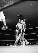 Nash vs Leon Championship Fight.    (N55)..1980..14.12.1980..12.14.1980..14th December 1980..At the Burlington Hotel, Dublin, Charlie Nash defended his European Lightweight Title when he took on Spain's Francesco Leon. .Back on his feet Nash is pictured hanging onto Leon as he recovers from the knockdown.