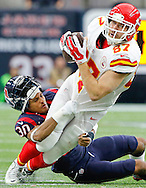 HOUSTON, TX - JANUARY 09:  Travis Kelce #87 of the Kansas City Chiefs is tackled by Kevin Johnson #30 of the Houston Texans in the second quarter during the AFC Wild Card Playoff game at NRG Stadium on January 9, 2016 in Houston, Texas.  (Photo by Thomas B. Shea/Getty Images) *** Local Caption *** Travis Kelce;Kevin Johnson