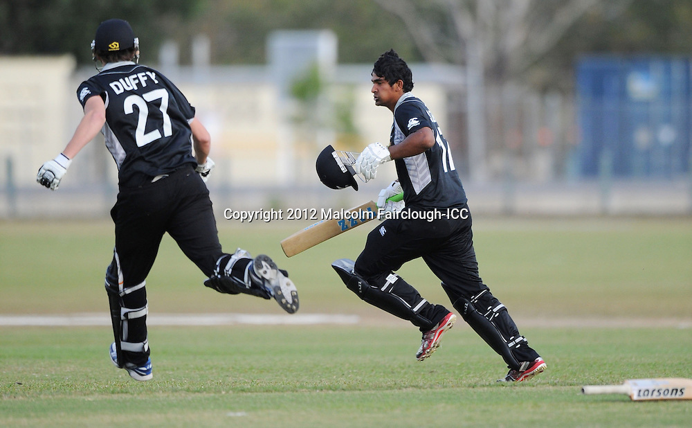 TOWNSVILLE, AUSTRALIA - AUGUST 20:  Ish Sodhi (R) of New Zealand celebrates with Jacob Duffy after hitting a four to score the winning runs during the ICC U19 Cricket World Cup 2012 Quarter Final match between New Zealand and the West Indies at Endeavour Park on August 20, 2012 in Townsville, Australia.  (Photo by Malcolm Fairclough-ICC/Getty Images)