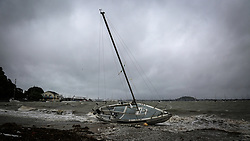 A yacht lies grounded as king tides lash Tamaki Drive, Auckland, New Zealand, Friday, January 05, 2018. Credit:SNPA / Hayden Woodward**NO ARCHIVING**