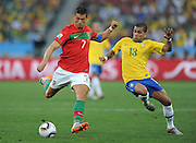 CRISTIANO RONALDO  (Portugal) takes on DANI ALVES during the 2010 FIFA World Cup South Africa Group G match between Portugal and Brazil at Durban Stadium on June 25, 2010 in Durban, South Africa.