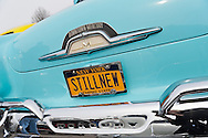 March 31, 2013 - Garden City, New York, U.S. - This blue Classic Ford Mercury with 'STILL NEW' license plates is in the 58th Annual Easter Sunday Vintage Car Parade and Show sponsored by the Garden City Chamber of Commerce. Hundreds of authentic old motorcars, 1898-1988, including antiques, classic, and special interest participated in the parade.