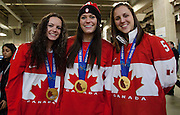 VANCOUVER, BC - MARCH 2: (L-R) Shannon Szabados, Natalie Spooner and Lauriane Rougeau members of the 2014 Canadian Olympic Women's gold medal hockey team pose for a photo prior to the 2014 Tim Hortons Heritage Classic between the Ottawa Senators and the Vancouver Canucks at BC Place on March 2, 2014 in Vancouver, B.C., Canada.  (Photo by Kevin Light/NHLI via Getty Images)