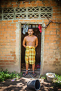 29 OCTOBER 2012 - MAYO, PATTANI, THAILAND:  A resident at the Bukit Kong home in Mayo, Pattani. He said he is a survivor of the Tak Bai incident in which the Thai army killed more than 80 people protesting against the government. He said he didn't remember his name or how he came to be at the home. The home opened 27 years ago as a ponoh school, or traditional Islamic school, in the Mayo district of Pattani. Shortly after it opened, people asked the headmaster to look after individuals with mental illness. The headmaster took them in and soon the school was a home for the mentally ill. Thailand has limited mental health facilities and most are in Bangkok, more than 1,100 kilometers (650 miles) away. The founder died suddenly in 2006 and now his widow, Nuriah Jeteh, struggles to keep the home open. Facilities are crude by western standards but the people who live here have nowhere else to go. Some were brought here by family, others dropped off by the military or police. The home relies on donations and gets no official government support, although soldiers occasionally drop off food. Now there are only six patients, three of whom are kept chained in their rooms.  Jeteh says she relies on traditional Muslim prayers, holy water and herbal medicines to treat the residents. Western style drugs are not available and they don't have a medic on staff.    PHOTO BY JACK KURTZ