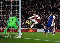 Football - 2018 / 2019 Premier League - Arsenal vs. Chelsea<br /> <br /> Lucas Torreira (Arsenal FC) leaps out the way as Alexandre Lacazette (Arsenal FC) scores the opening goal past Marcos Alonso (Chelsea FC) at The Emirates.<br /> <br /> COLORSPORT/DANIEL BEARHAM