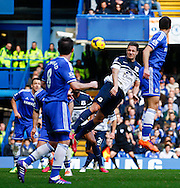 Phil Jagielka of Everton (2nd right) goes close with a header during the Barclays Premier League match at Stamford Bridge, London<br /> Picture by David Horn/Focus Images Ltd +44 7545 970036<br /> 22/02/2014