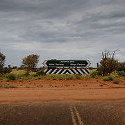 Sign to Kings Canyon and Alice Springs. Larapinta Drive Mereenie Loop in Northern Territories.