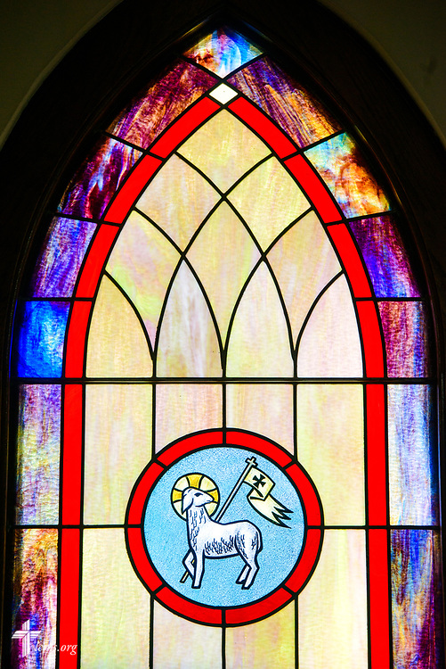 Stained glass depicting the Lamb of God, and the victory over death in the resurrection of Jesus Christ, at Zion Evangelical Lutheran Church, Lu Verne, Iowa, on Sunday, July 9, 2017. LCMS Communications/Erik M. Lunsford