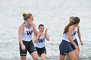 San Diego, California. USA.  University of Washington women, carry the cox to the waters edge before dunking here in the traditional manner.  2013 Crew Classic Regatta, Mission Bay.  11:55:47.  Sunday  07/04/2013   [Mandatory Credit. Peter Spurrier/Intersport Images]  ..