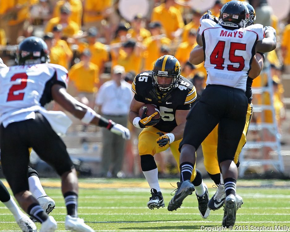 August 31 2013: Iowa Hawkeyes running back Mark Weisman (45) eyes some running room during the first quarter of the NCAA football game between the Northern Illinois Huskies and the Iowa Hawkeyes at Kinnick Stadium in Iowa City, Iowa on August 31, 2013. Northern Illinois defeated Iowa 30-27.